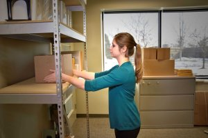 "Women reaching for box located on shelf, inside her ""Power Zone""."