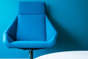 blue office chair and walls