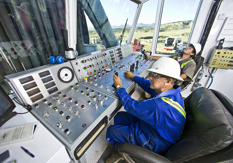 Two men working at controls
